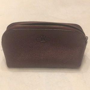 Coach maroon pebbled leather mini-zip up bag.